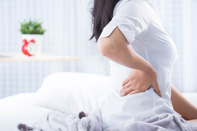 6 Simple Sciatica Stretches You Can Do In Bed